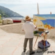 Pittore sulla spiaggia di Positano
